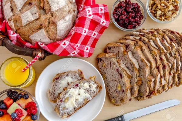 37050044-walnut-and-cranberry-whole-grain-bread-sitting-on-plate-with-butter-fruit-and-orange-juice-from-abov.jpg