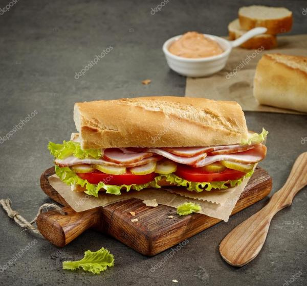 depositphotos_119530394-stock-photo-sandwich-with-smoked-meat-and.jpg
